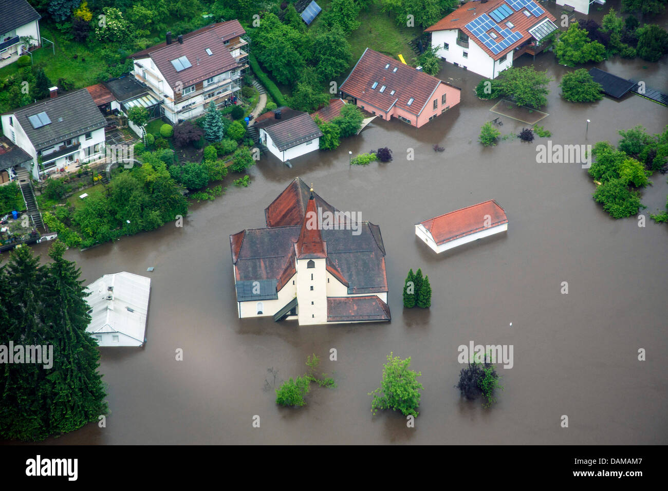 church and houses at rivers Ilz flooded in June 2013, Germany, Bavaria, Passau - Stock Image