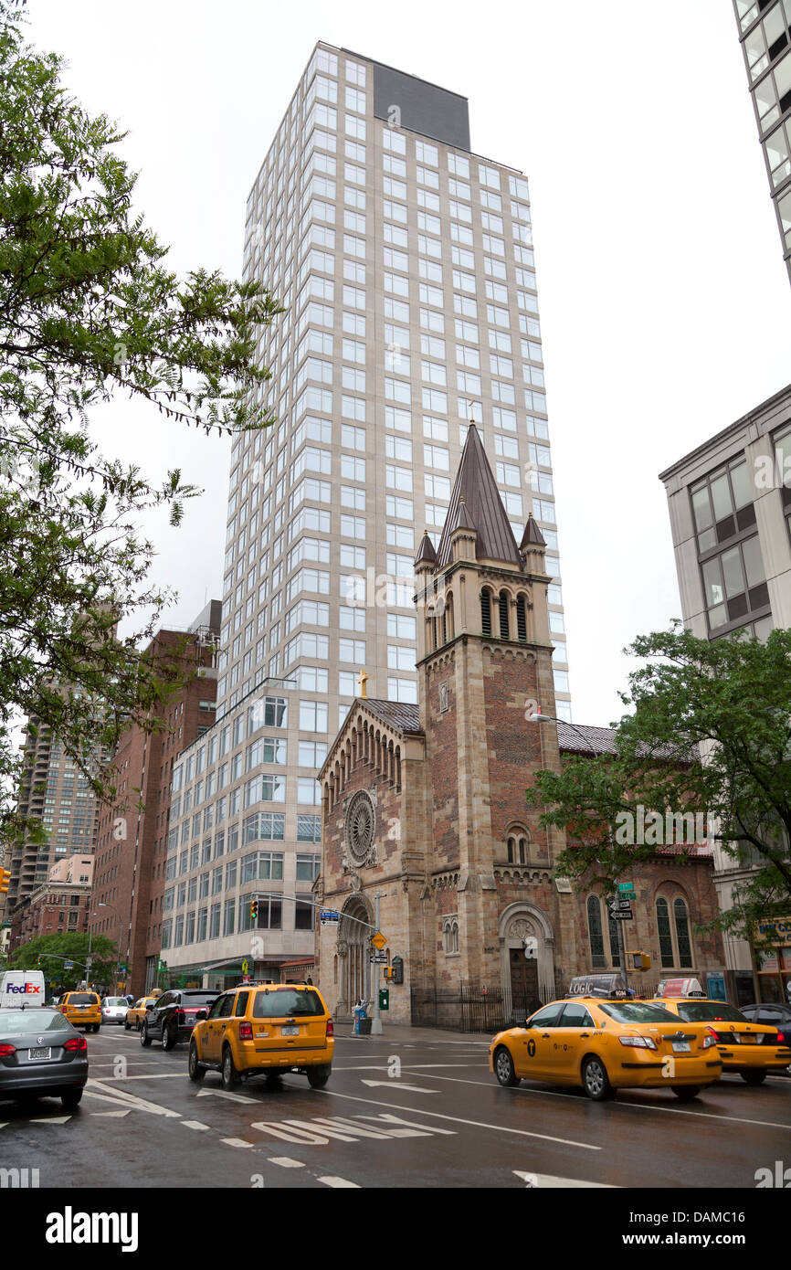 Old church and new sky scraper in NYC, Manhattan - Stock Image