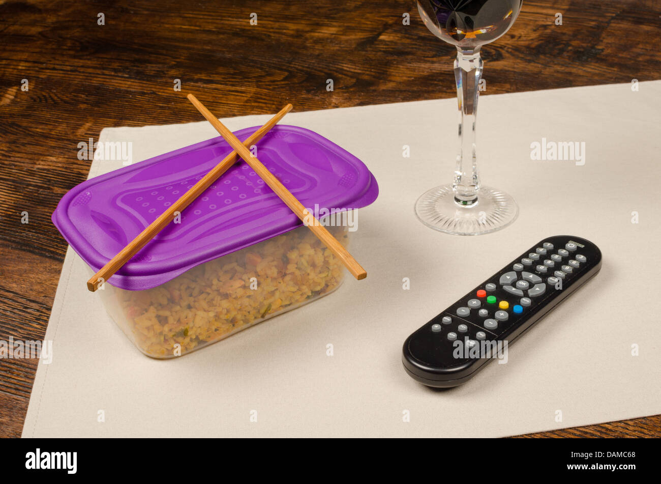 Leftovers dinner out of the food box, a bachelor meal - Stock Image