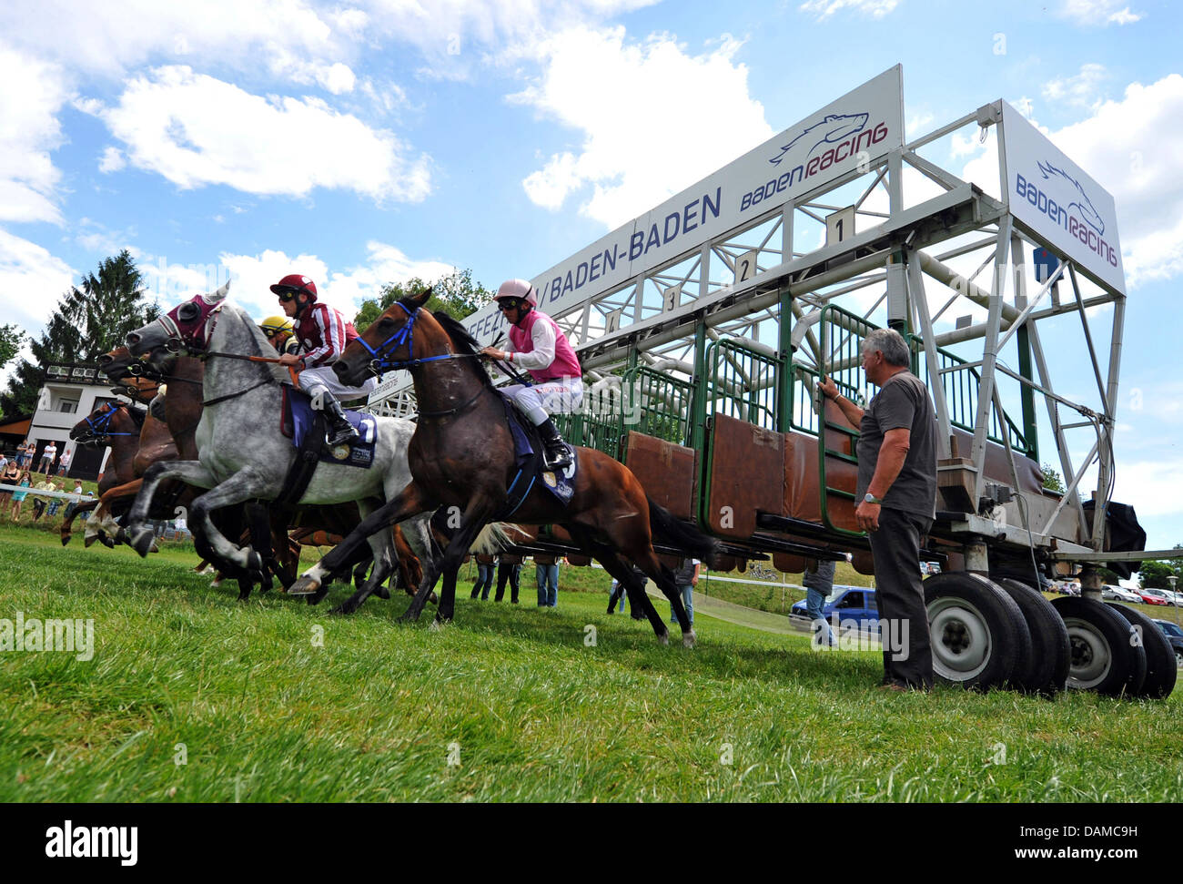 A group of horse riders start a race at the horse race track Iffezheim on the last day of the so-called Spring Meeting - Stock Image
