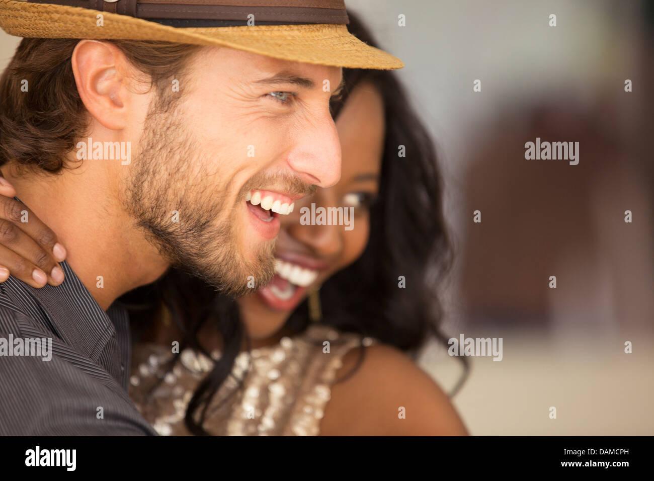 Smiling couple hugging - Stock Image