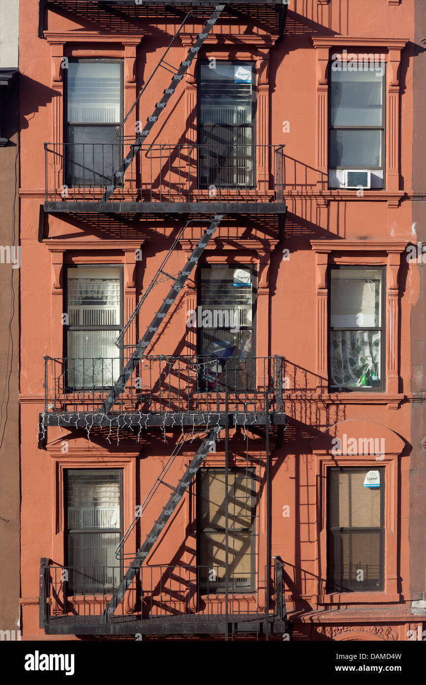 Apartment buildings with fire escapes in New York City - Stock Image