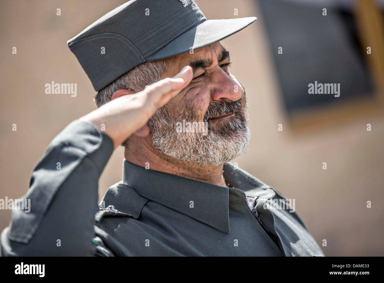 The Provincial Chief of Police Gen. Abdul Hakim salutes during a police graduation ceremony July 14, 2013 in Farah - Stock Image