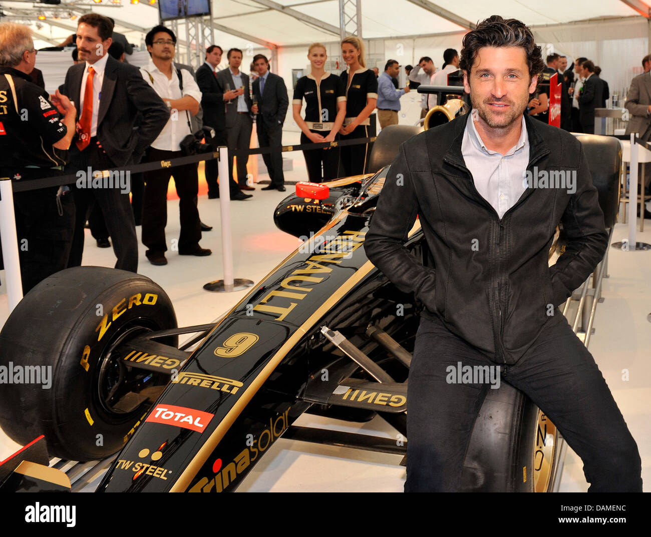 Us Actor Patrick Dempsey Sits On The Tyre Of A Formula One Racing