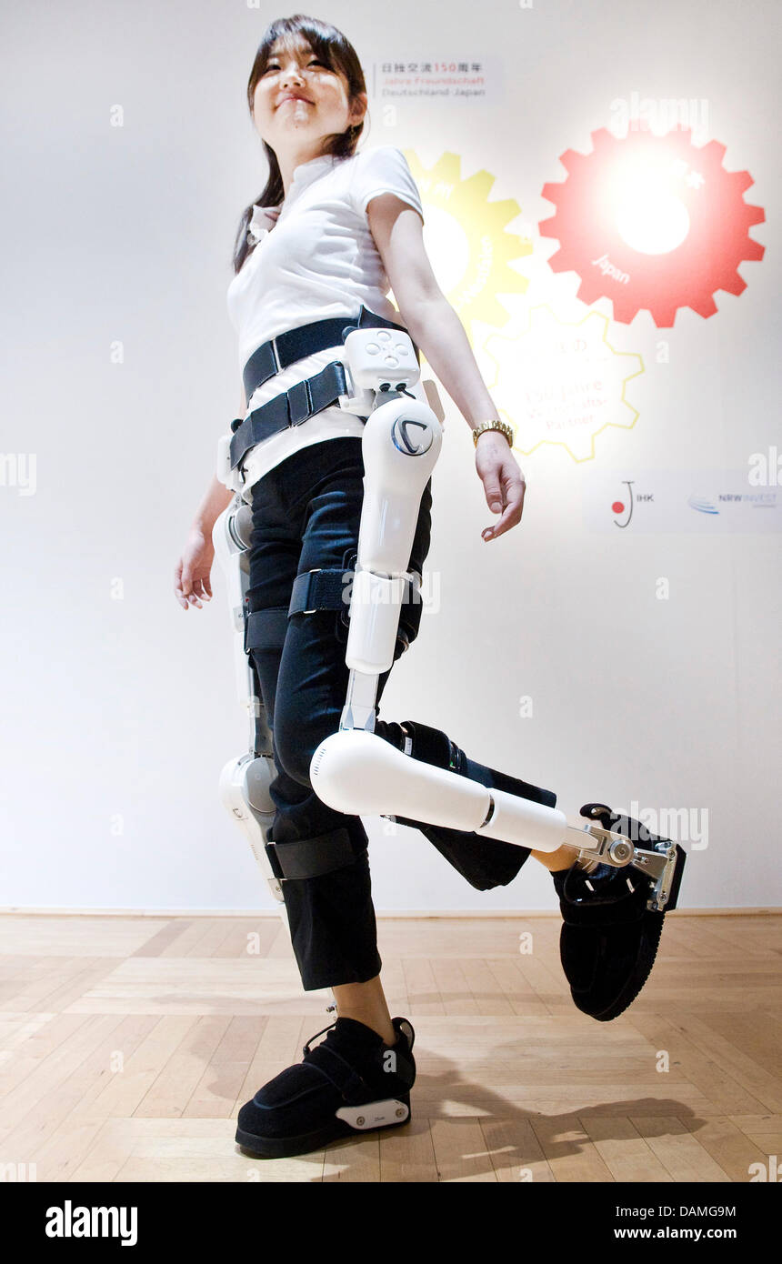 A Young Woman Presents The Robot Suit Hybrid Assistive