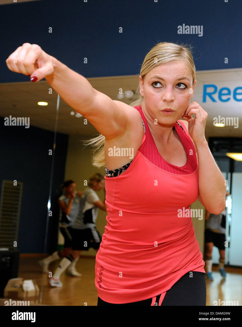 Former world boxing champion Regina Halmich is boxing with the German national soccer team during a training session - Stock Image