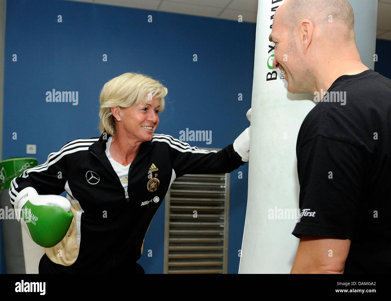 Head coach Silvia Neid of the German national soccer team punches a bag during a training session at a Fitness First - Stock Image