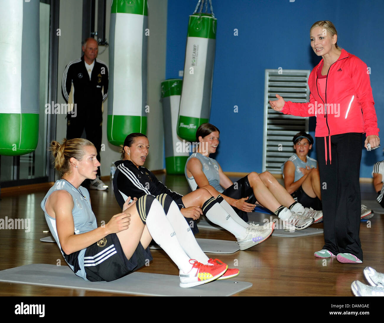 Former boxing world champion Regina Halmich is talking to players of the German national soccer team during a training - Stock Image