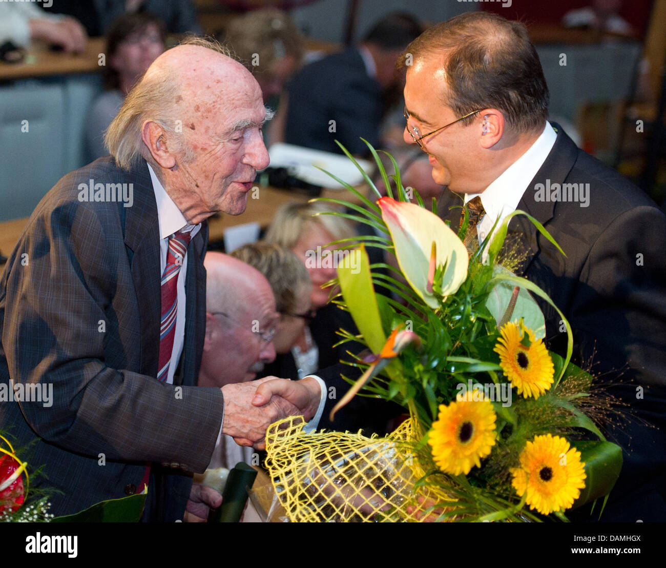 The Translator Karl Dedecius L Receives Flowers For His 90th Stock