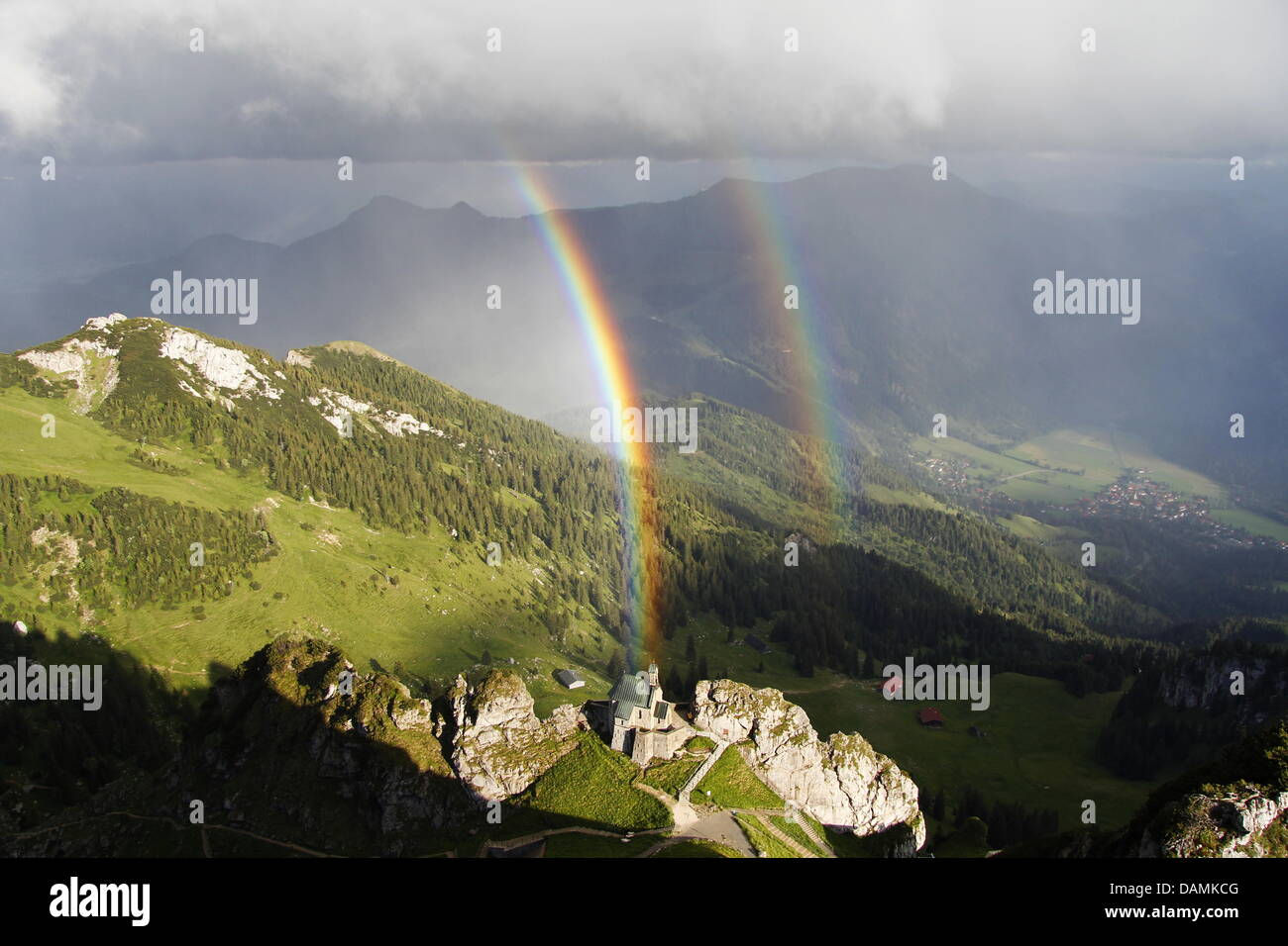 Two rainbows swing across the 1838-metres high Wendelstein in Bayrischzell, Germany, 19 June 2011. One - Stock Image