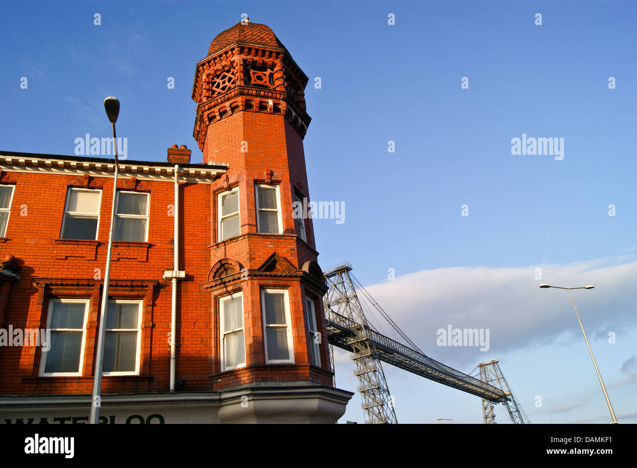 Waterloo Hotel (1870) and the transporter bridge, at sunset, Newport, Cas Newydd, Wales - Stock Image