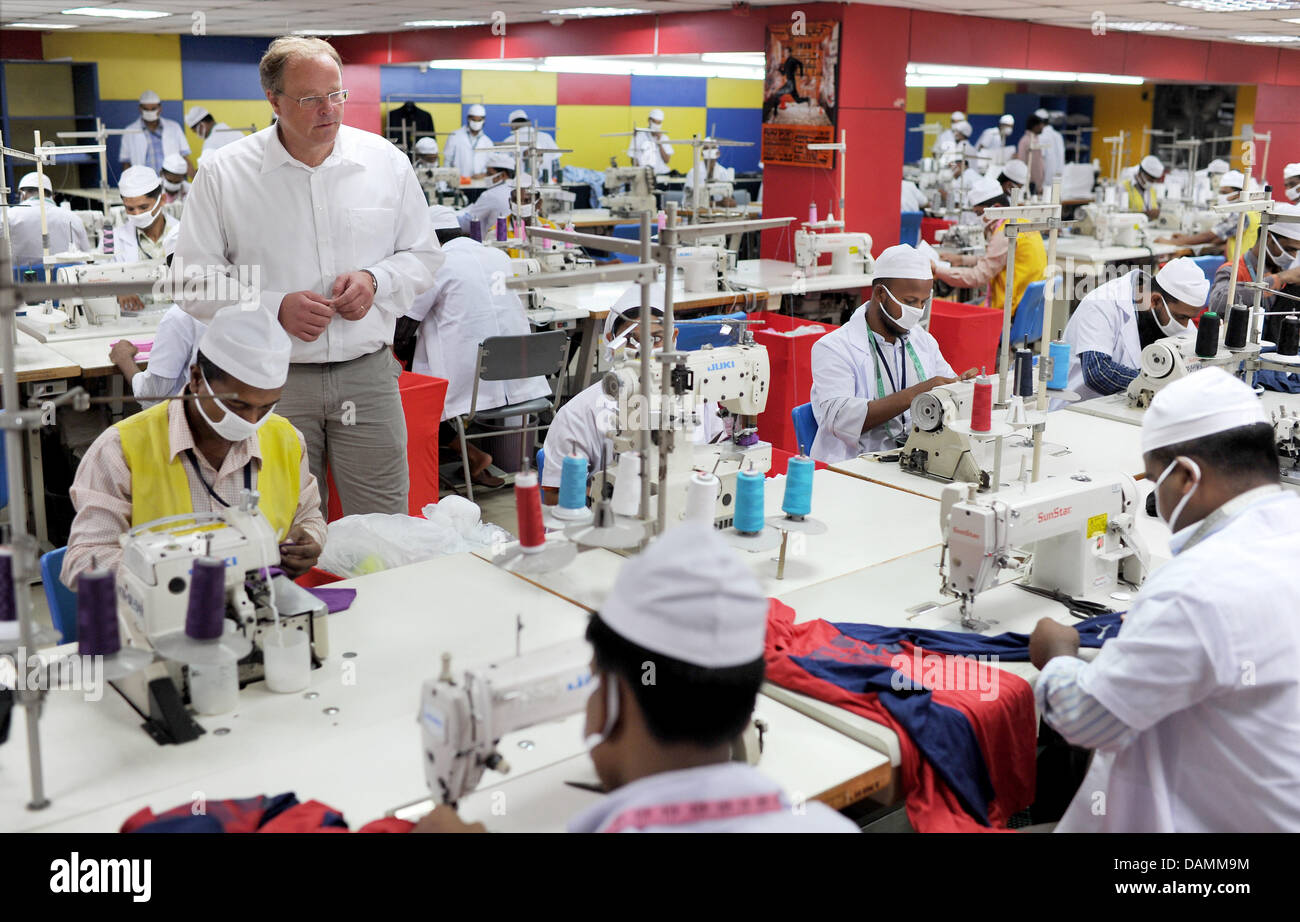 German Development Minister Dirk Niebel visits a textile factory in
