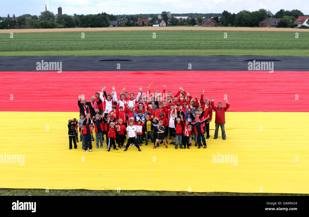The youth group of the sport club St. Vit, who helped roll out the huge German flag on the occassion of the FIFA Women's - Stock Image