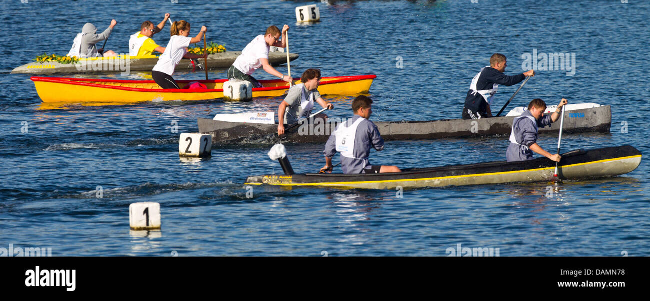 Participants paddle during the 13th German concrete canoe regatta on Lake Salbke in Magdeburg, Germany, 25 - Stock Image