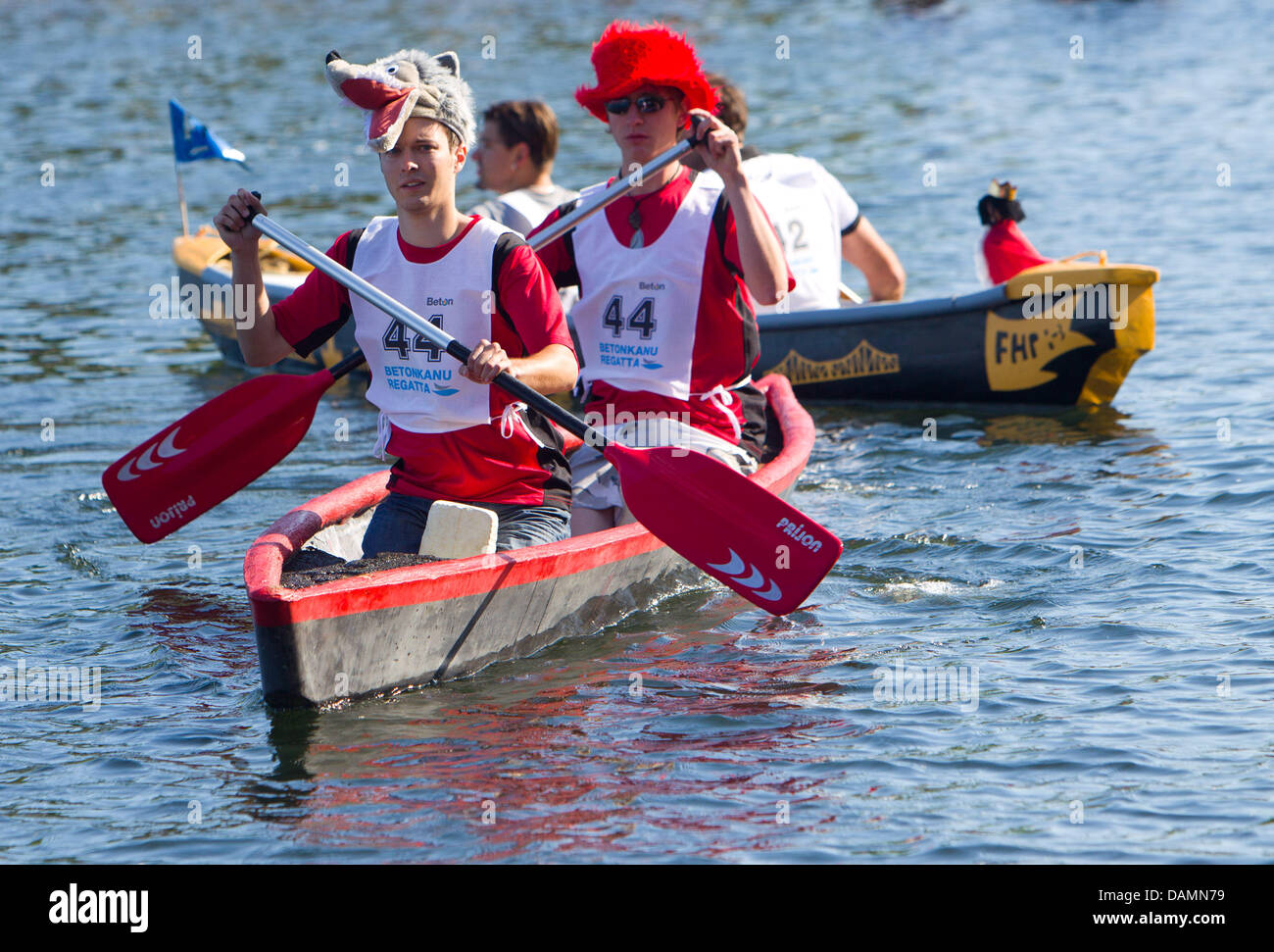 Participants from the university of Regensburg paddle in their canoe 'Mean Wolf' during the 13th German - Stock Image