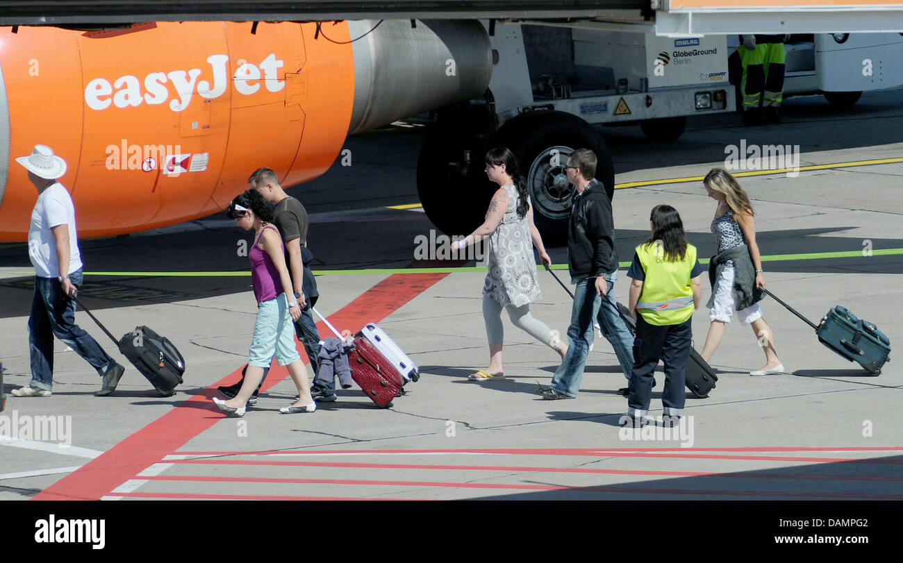 Passengers leave an airplane of the British airline Easyjet at Berlin-Schoenefeld Airport in Schoenefeld, Germany, - Stock Image