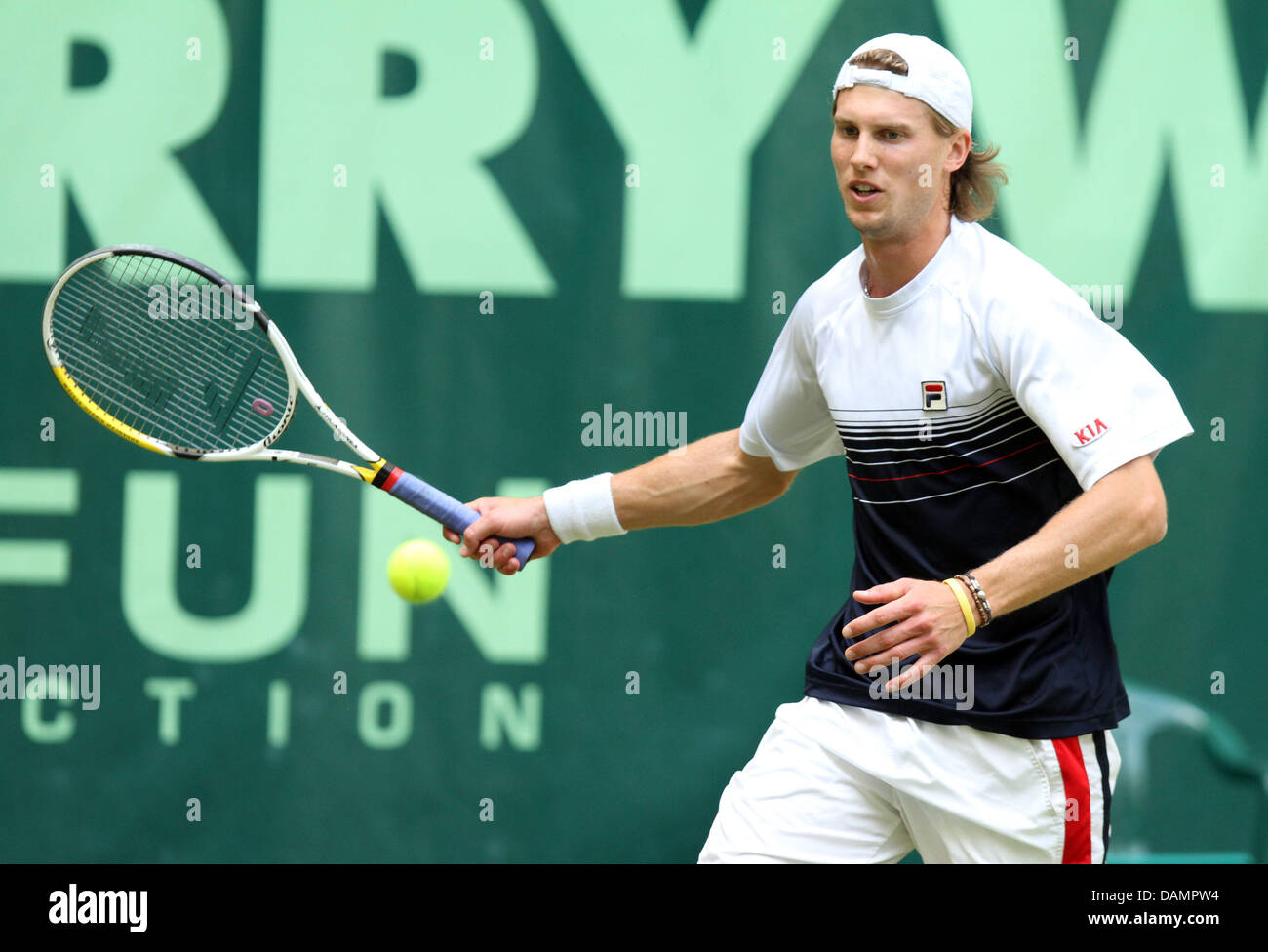 Italian player Andreas Seppi plays the ball in the ATP Tour first round match againstGermany's Tommy Haas - Stock Image
