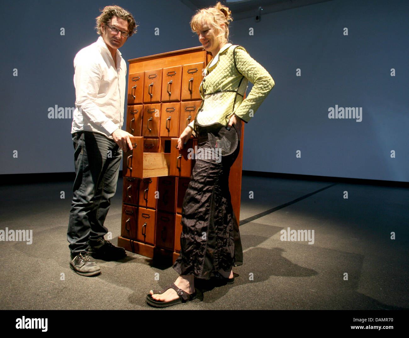 Canadian artists George Bures Miller and Janet Cardiff stand next to their work 'Cabinet of Curiousness' - Stock Image
