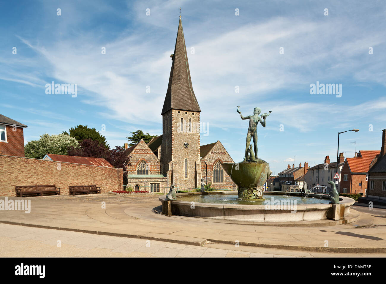 Great Britain England Essex Braintree St Michaels Church with Bronze Statue of Young Boy holding Dolphins with Sea - Stock Image