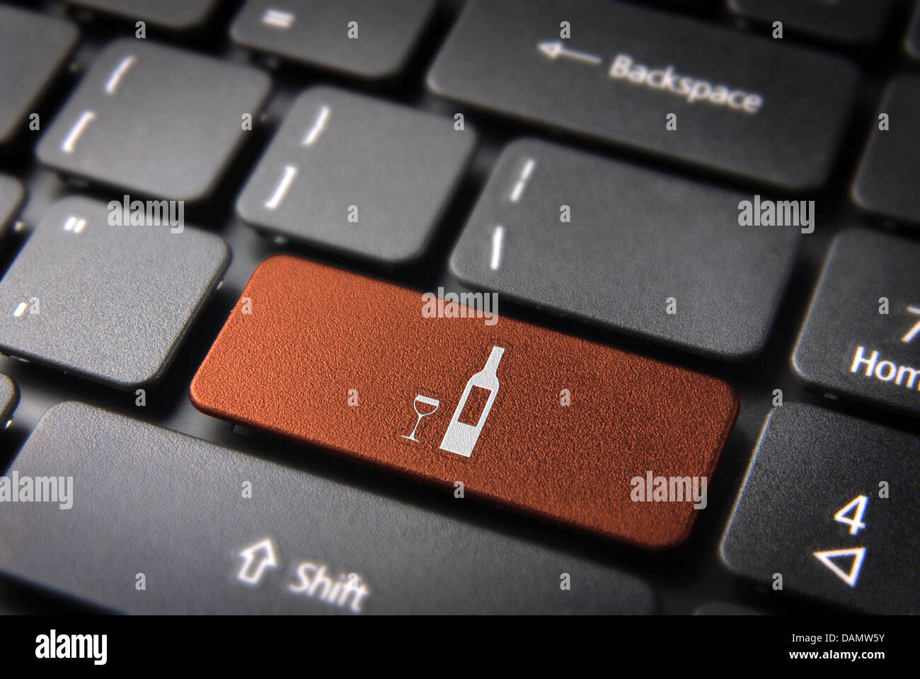 Food key with Wine bottle and cup icon on laptop keyboard. Included clipping path, so you can easily edit it. Stock Photo
