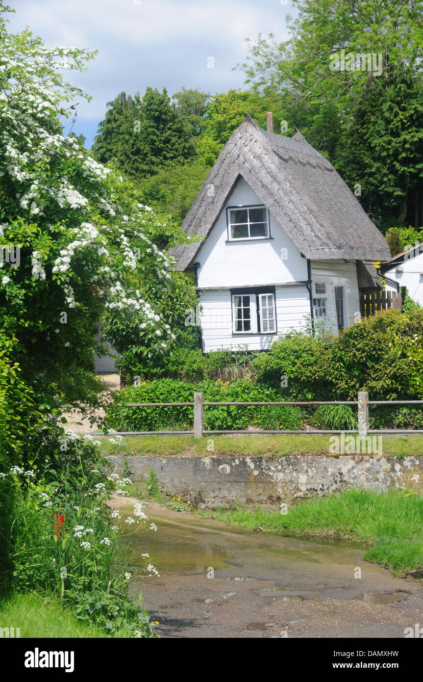 Small 19th c. thatched cottage by the ford in Clavering, Essex, England - Stock Image