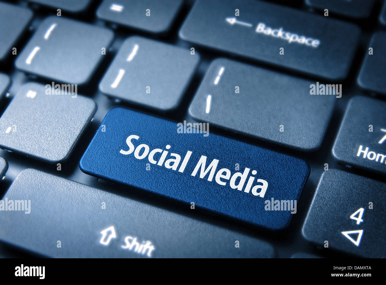 Close up key with social media icon on laptop keyboard. Included clipping path, so you can easily edit it. Stock Photo