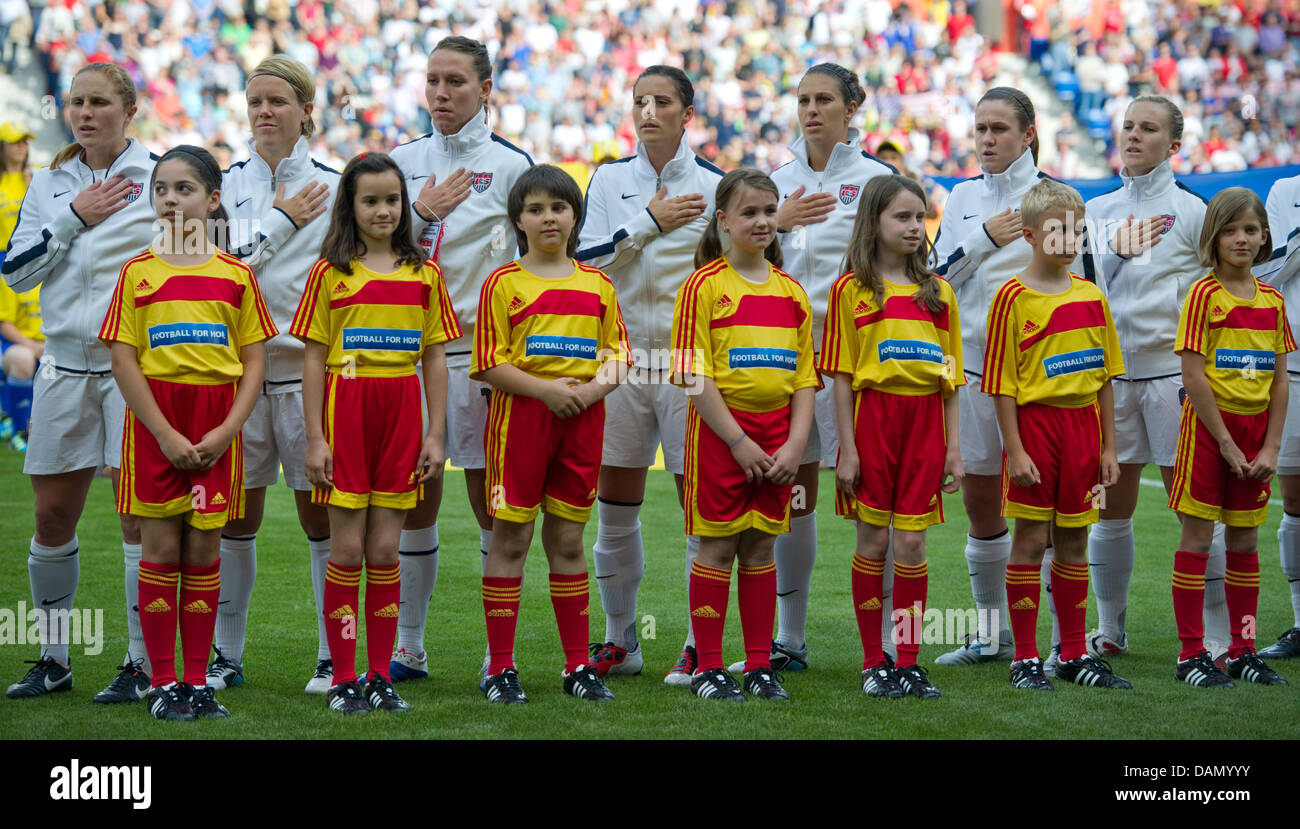 Players of the US-Team sing the national anthem during the Group C match USA against Colombia of FIFA Women's - Stock Image