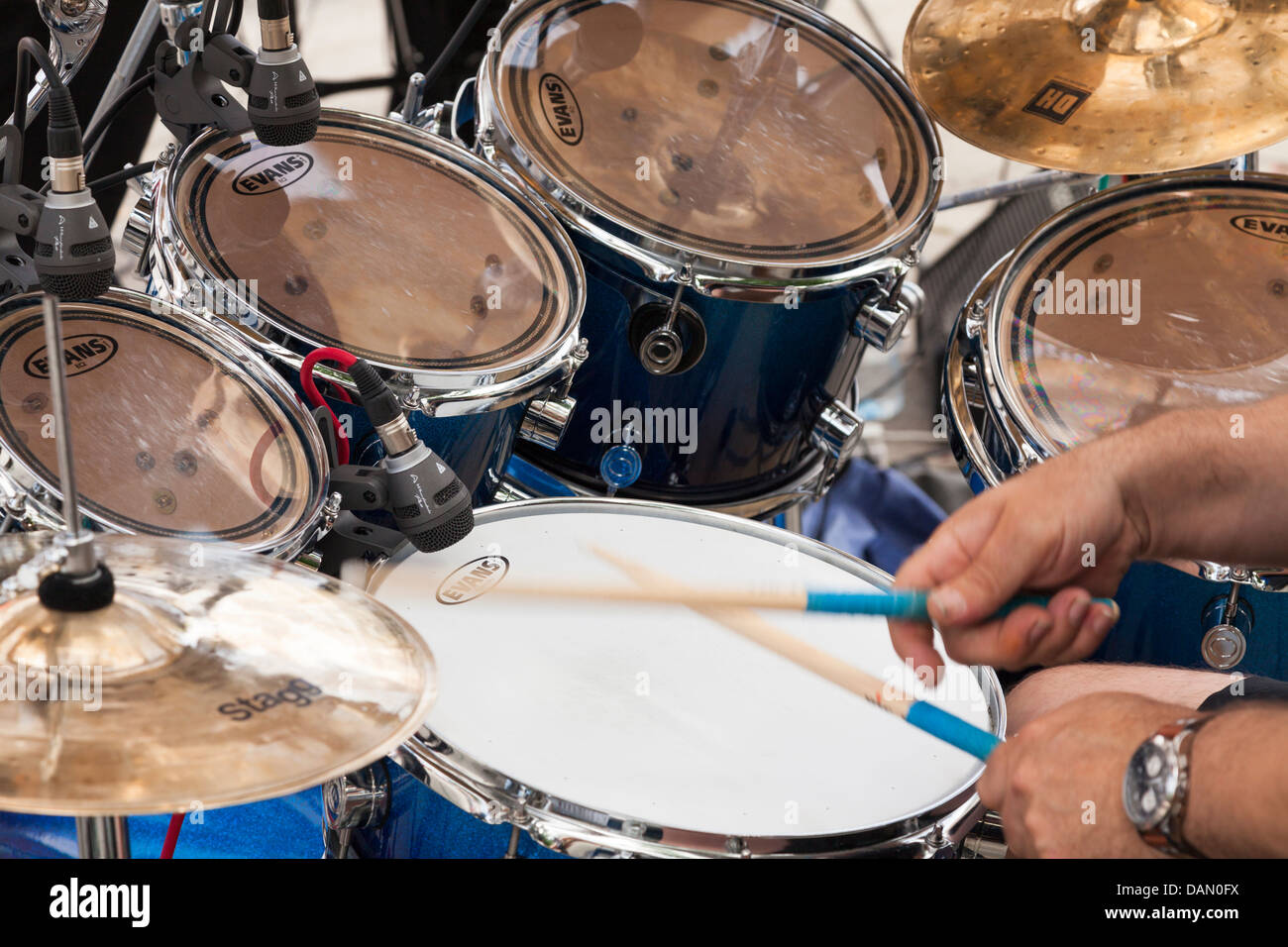 close up of drummer hands and drum kit - Stock Image