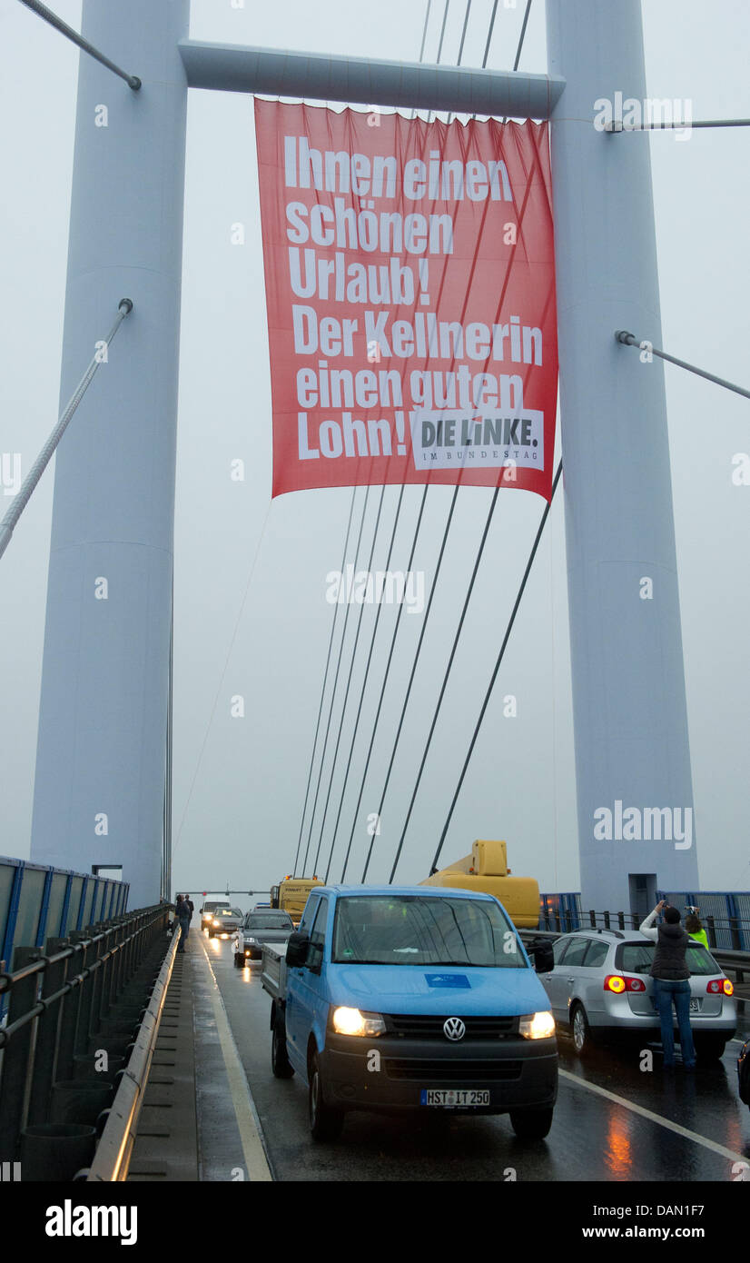 A banner from 'Die Linke' (The Left) political party hangs on Ruegen Bridge in Stralsund, Germany, 04 July - Stock Image