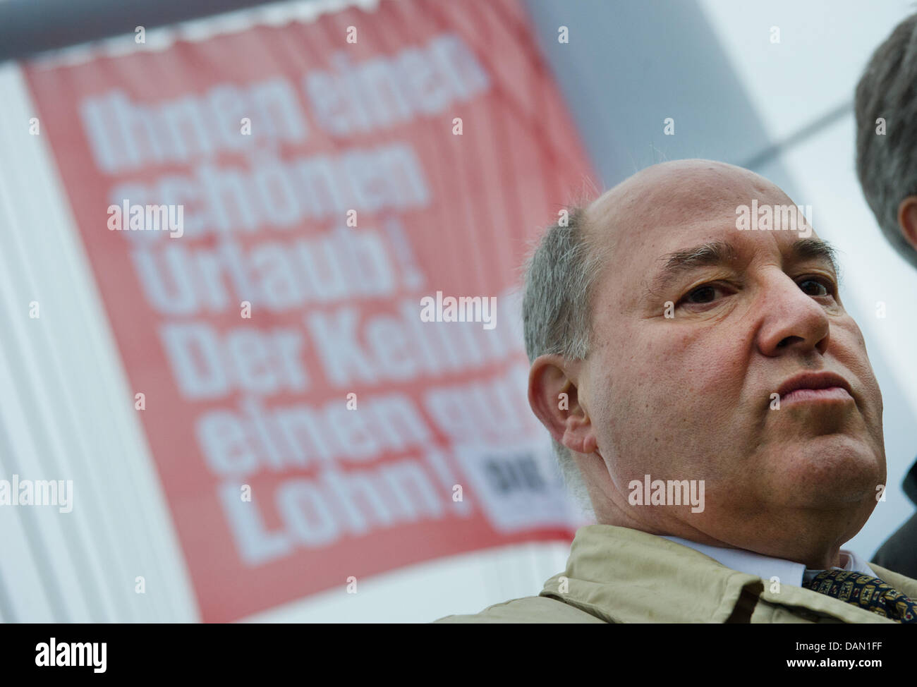 Chairman of parliamentary group of 'Die Linke' (The Left) party, Gregor Gysi, stands in front of a protest - Stock Image