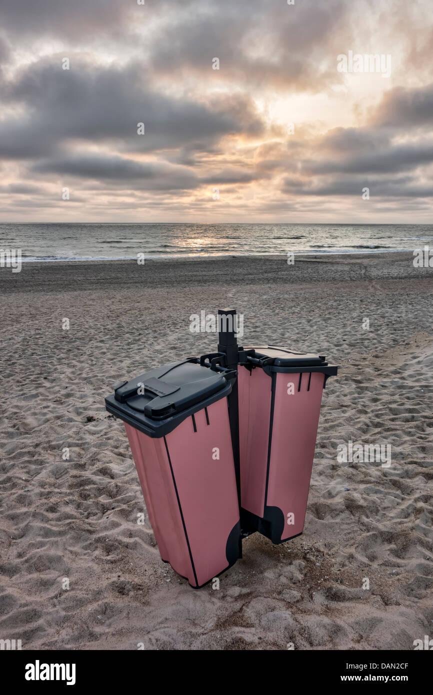 Litter boxes on the beach in Houvig, Denmark - Stock Image