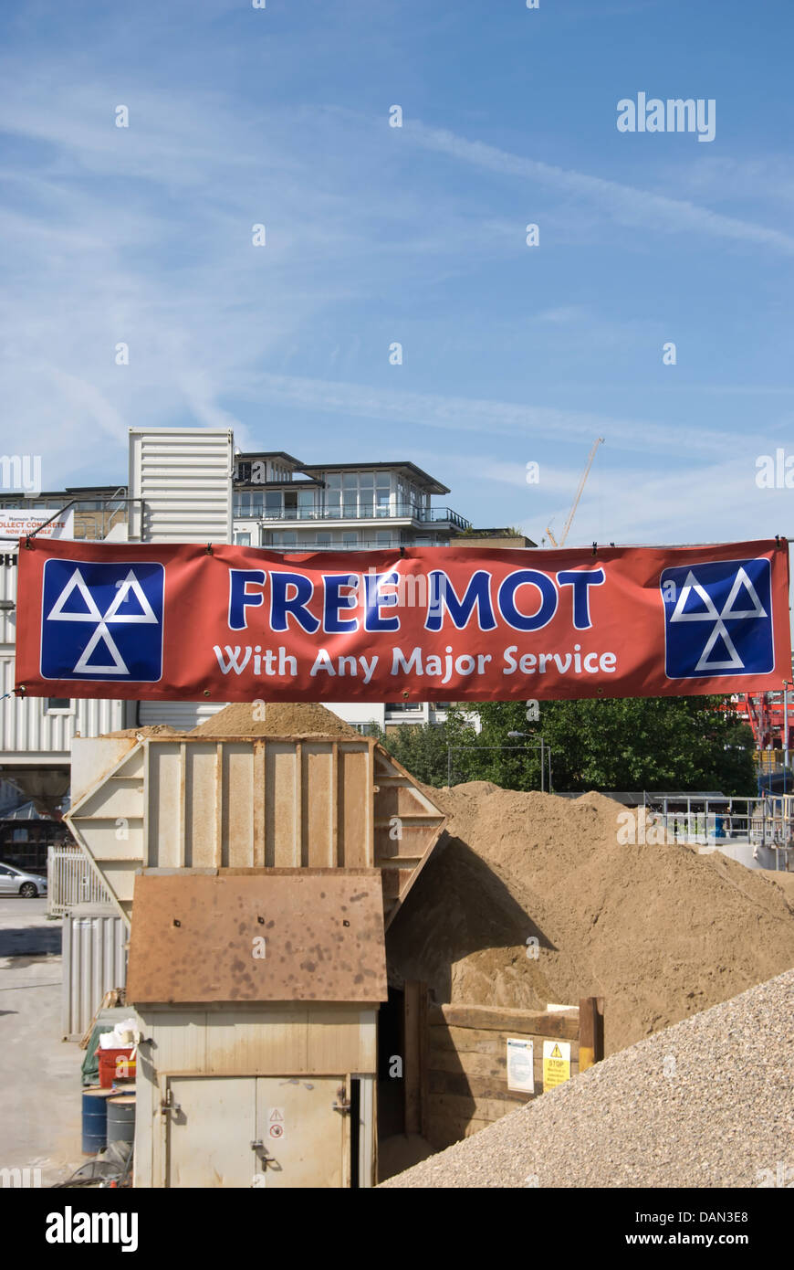 banner advertising a free mot with any major service, wandsworth, southwest london, england - Stock Image
