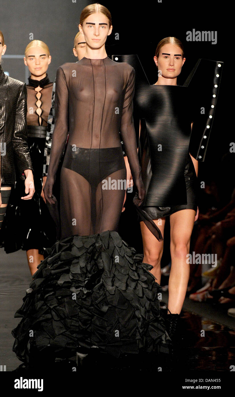 Models present creations of Markus Schmidbauer during the Mercedes-Benz Fashion Week in Berlin, Germany, 06 July - Stock Image