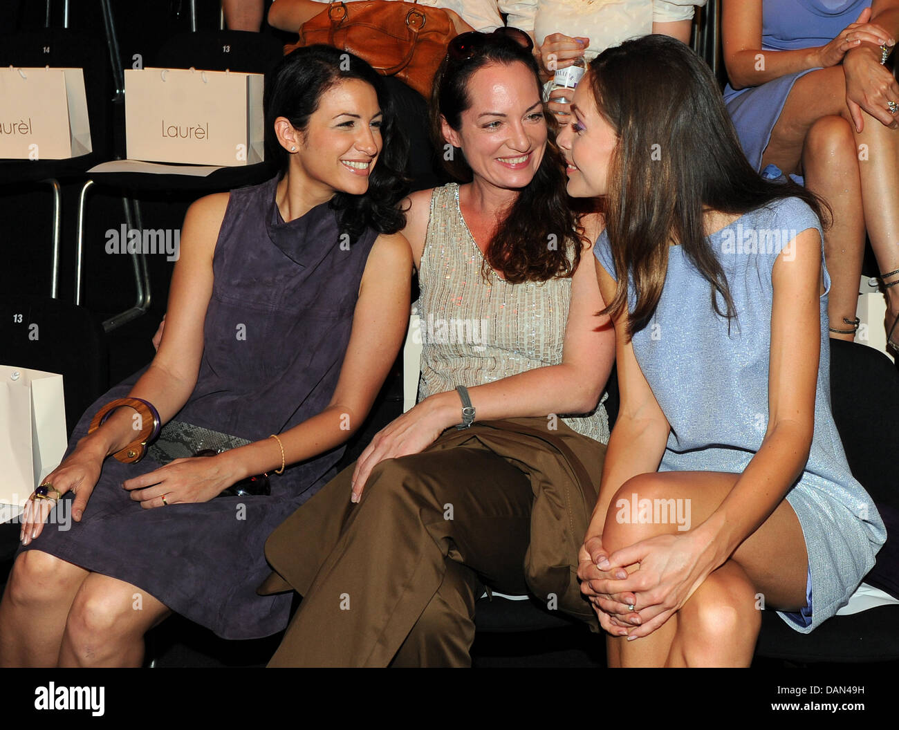 Minu Barati-Fischer (L), Natalia Wörner and Nadine Warmuth attend the show of the label Laurel during the Mercedes - Stock Image