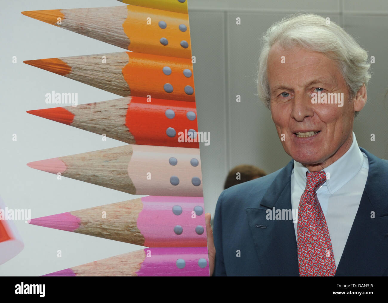 Head of the company Anton Wolfgang Duke of Faber Castell poses next to a picture of pencils after the official ceremony - Stock Image