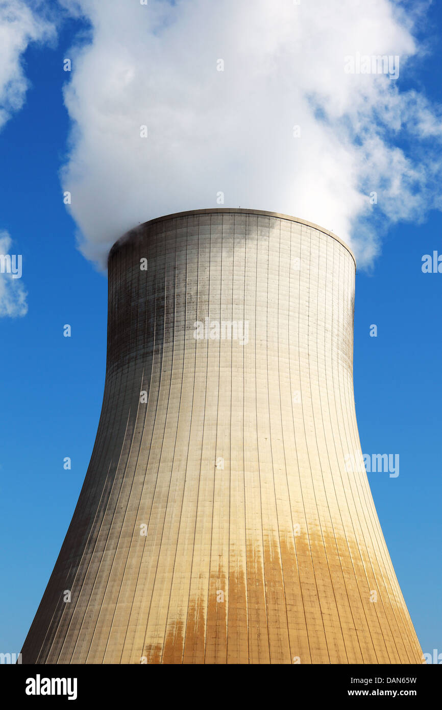 Nuclear power station cooling tower in blue sky - Stock Image