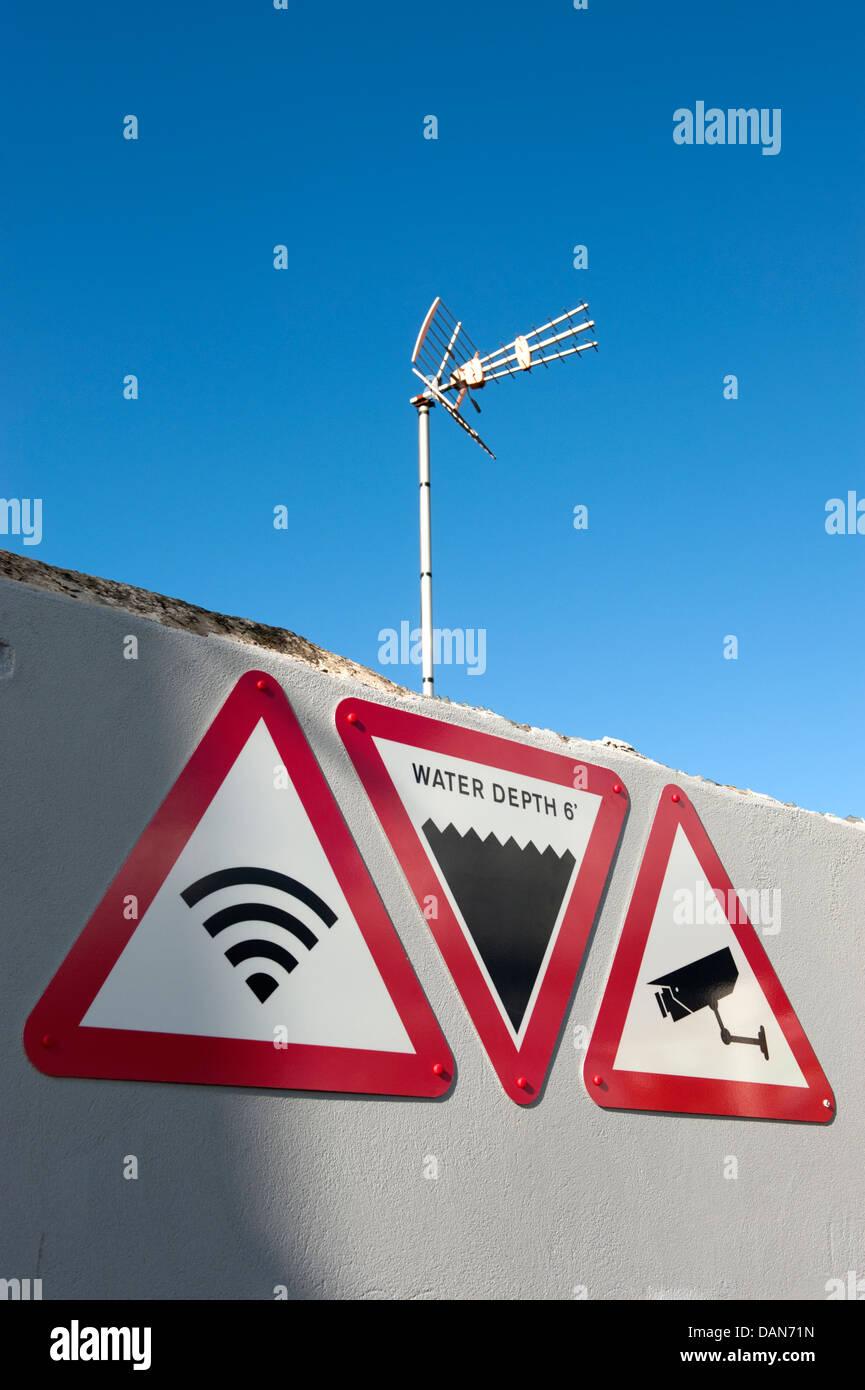 Warning Sign Deep Water TV Aerial CCTV WiFi - Stock Image