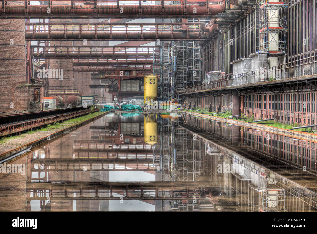 The industrial reflection pool in the deserted Zollverein coking plant in Essen, Germany. - Stock Image