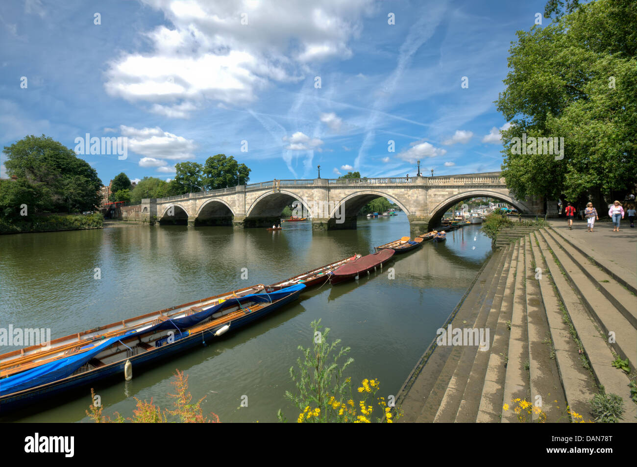 The Thames riverside at Richmond-upon-Thames, a popular London suburb and the Richmond Bridge, built between 1774 - Stock Image