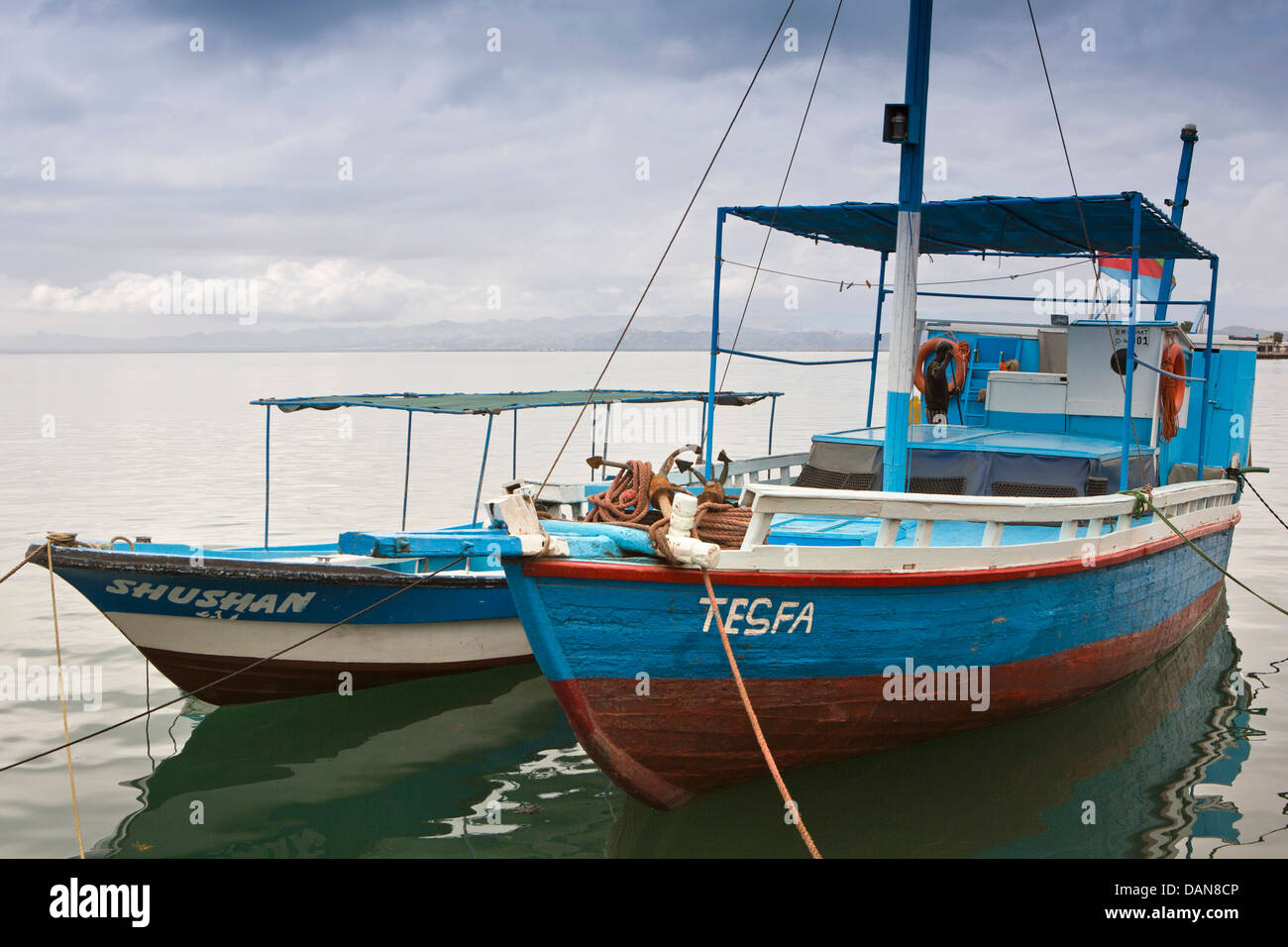 Africa, Eritrea, Massawa, colourfully painted wooden boats moored in harbour - Stock Image