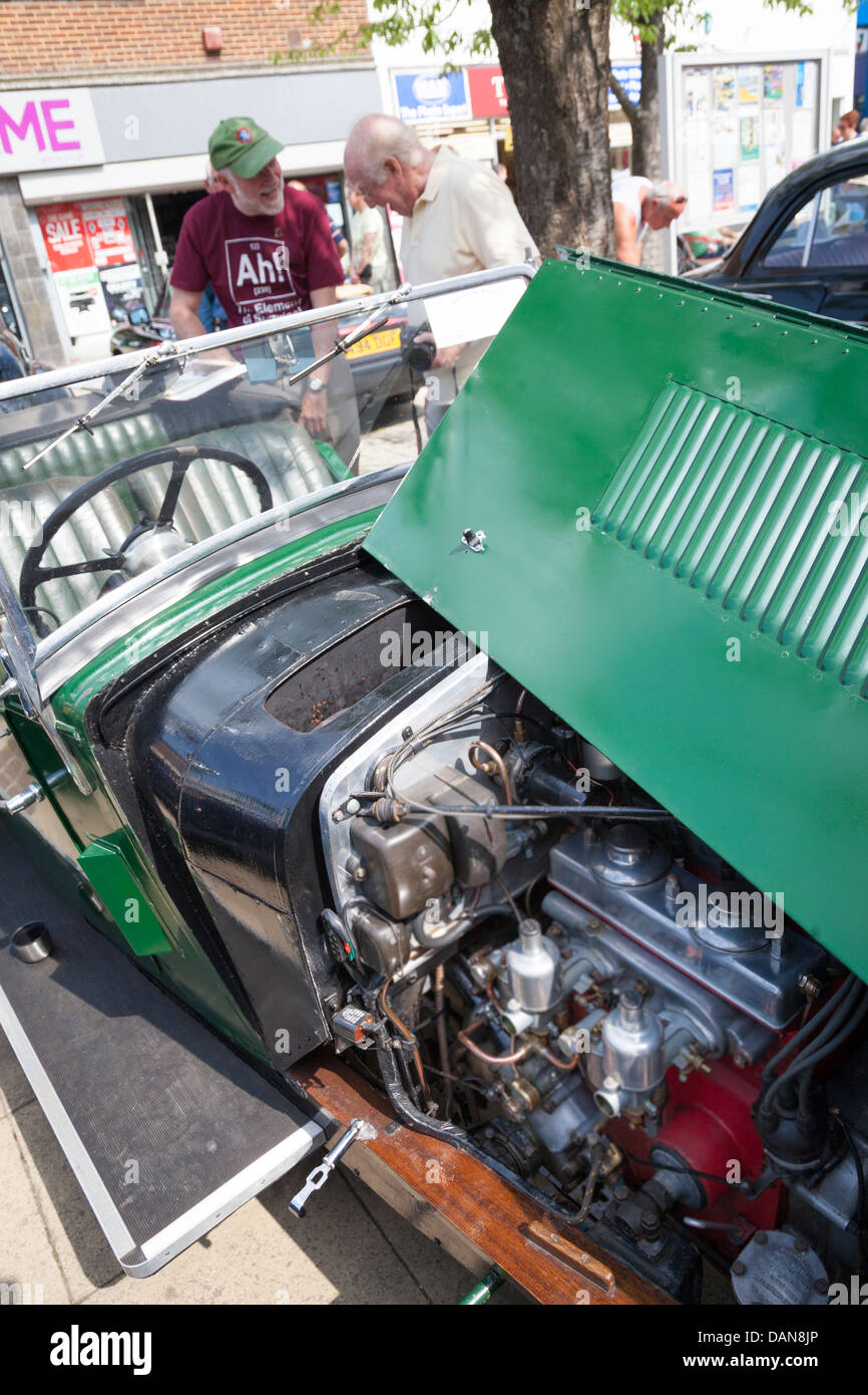 open bonnet of Riley classic car enthusiasts discussing - Stock Image