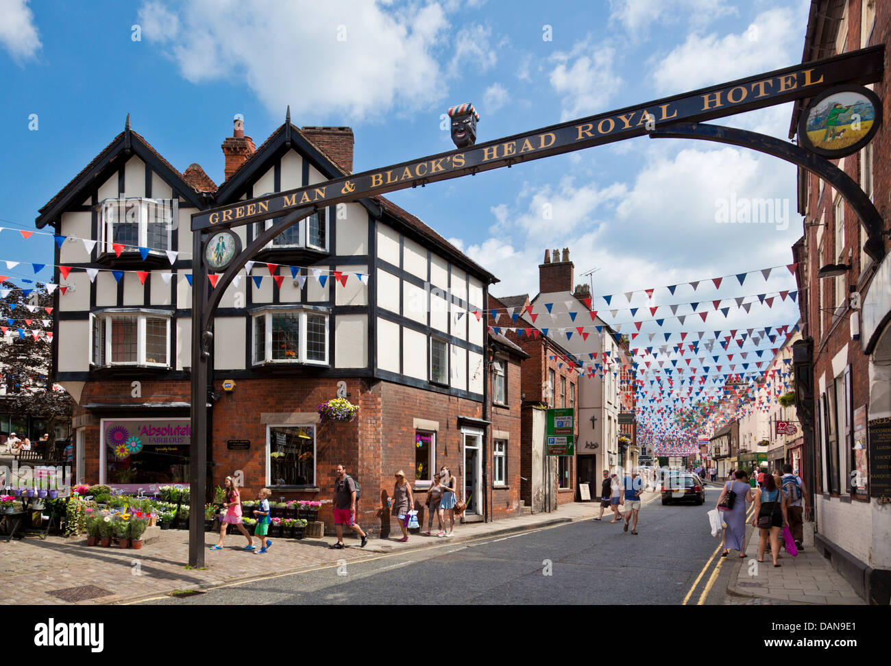 Town centre main street decked with bunting Ashbourne Derbyshire England UK GB EU Europe - Stock Image