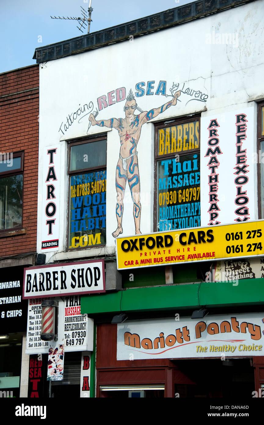 Gawdy High Street Shops Manchester UK - Stock Image