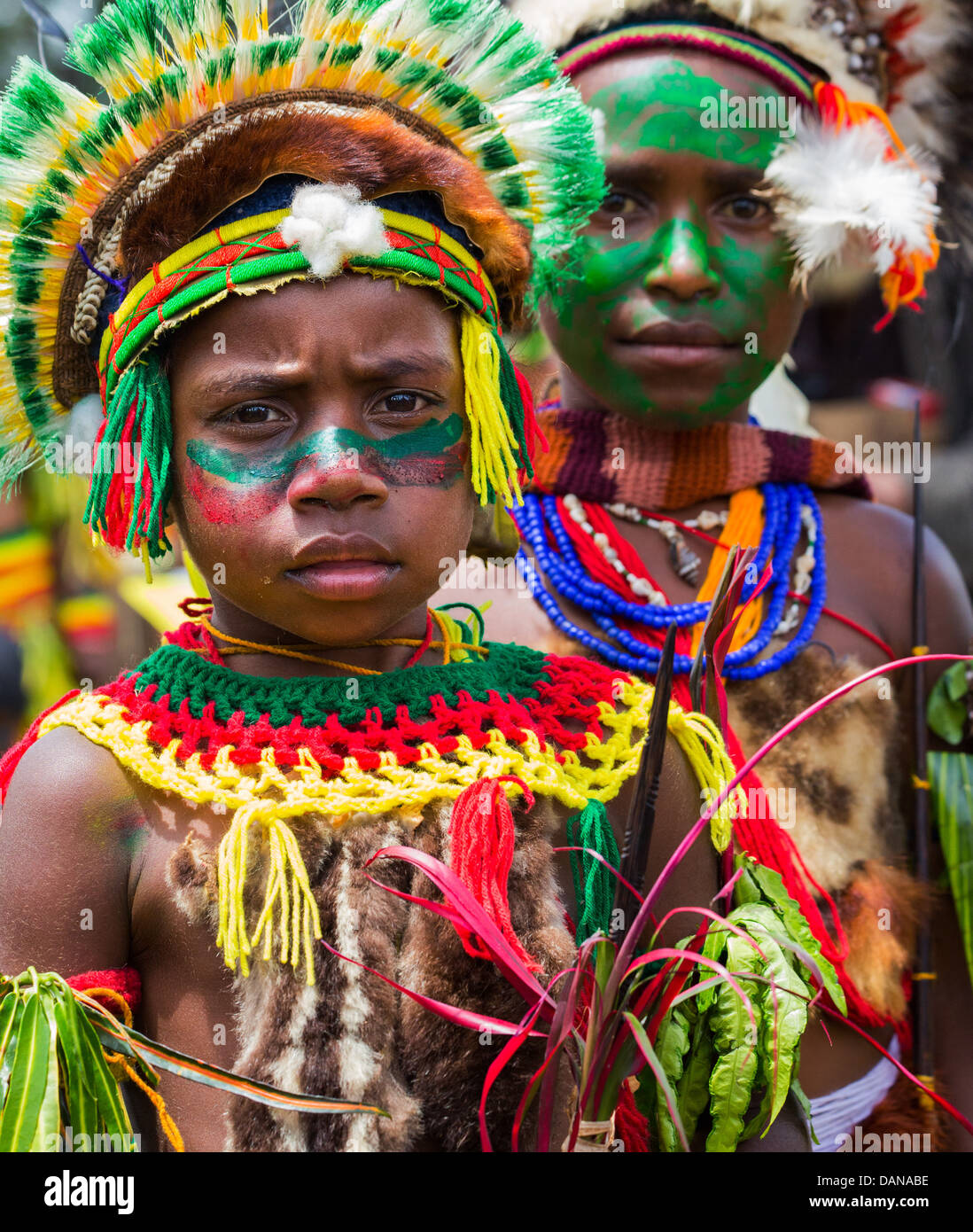Young boy with his face painted and wearing a tribal headdress at the Goroka show in the Papua New Guinea highlands - Stock Image