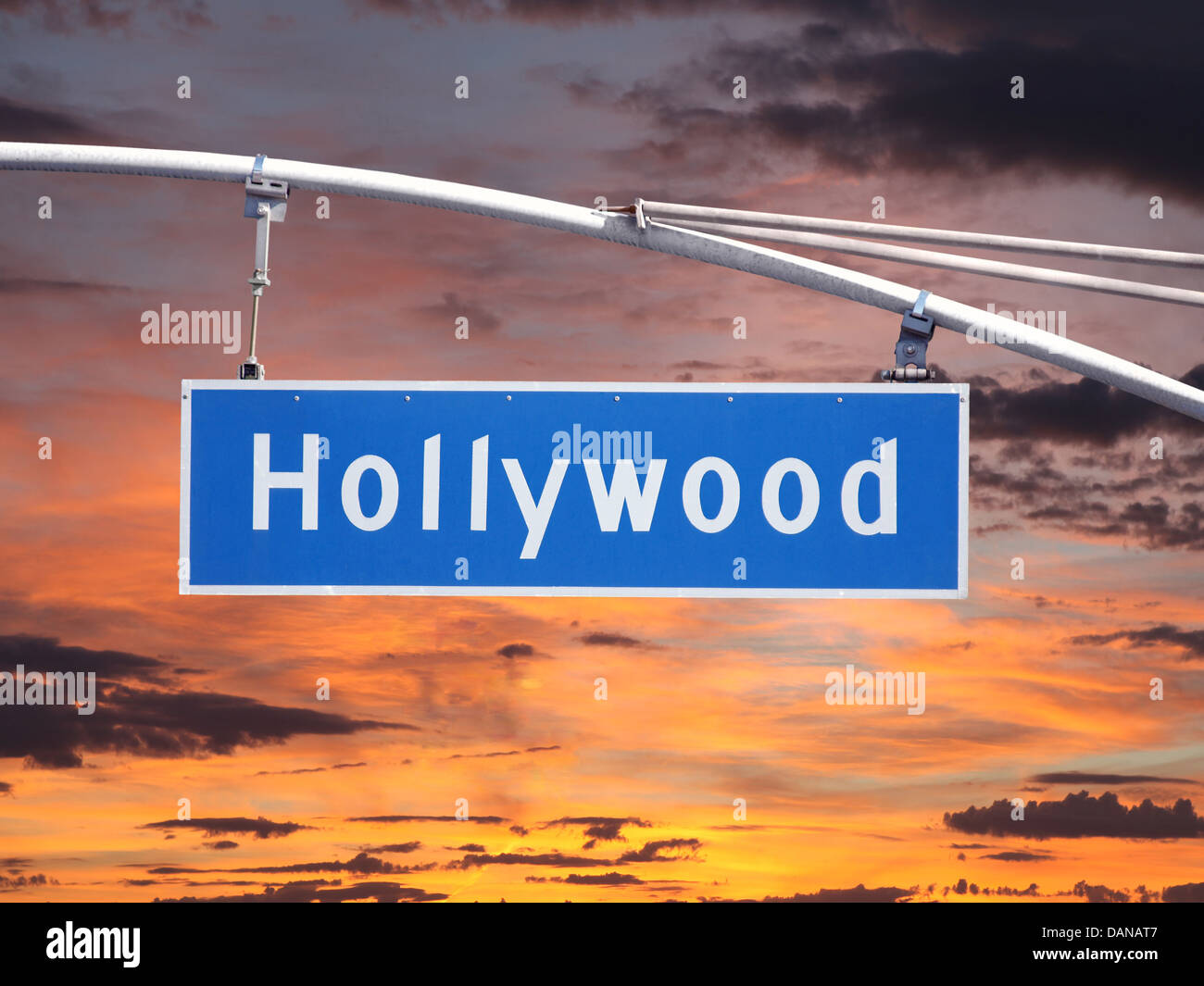 Hollywood Blvd overhead street sign with sunset sky. - Stock Image