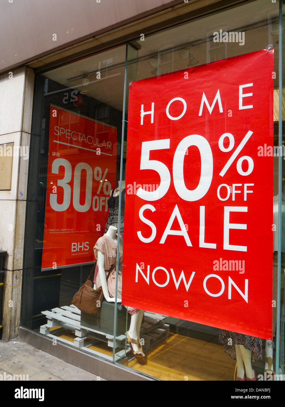 50% off sale sign in a clothes shop, York, England. - Stock Image