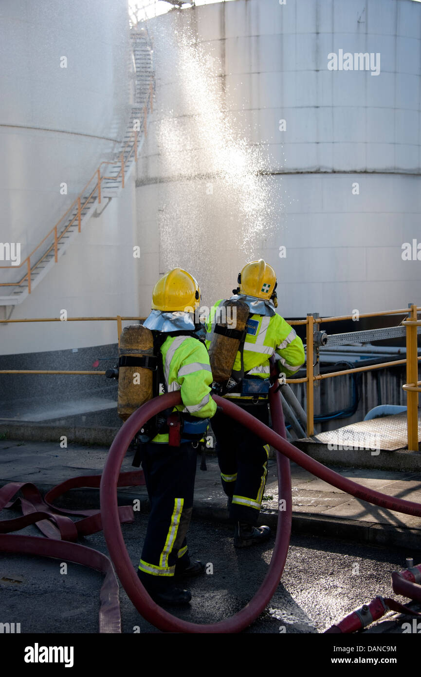 Firefighters tackling fire at petrochemical refinery SIMULATION - Stock Image