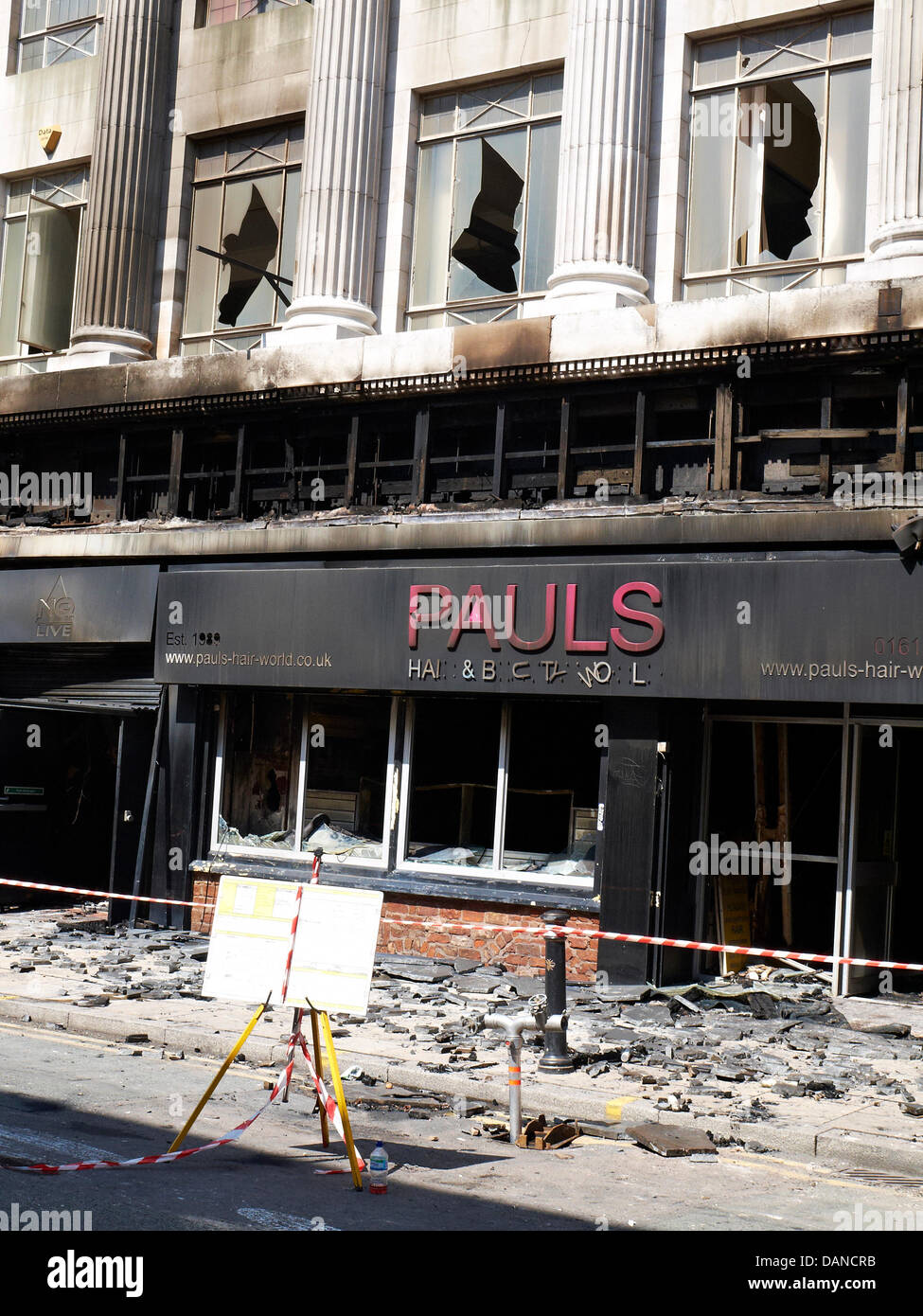 Manchester, UK. 16th July, 2013. Pauls hairshop in Oldham Street, which was destroyed  by fire on Saturday 13th - Stock Image