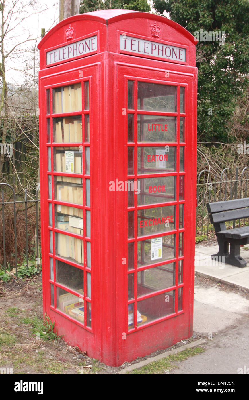 De-commissioned British Telecoms telephone box transformed into a community book exchange, Little Eaton, Derbyshire,UK - Stock Image