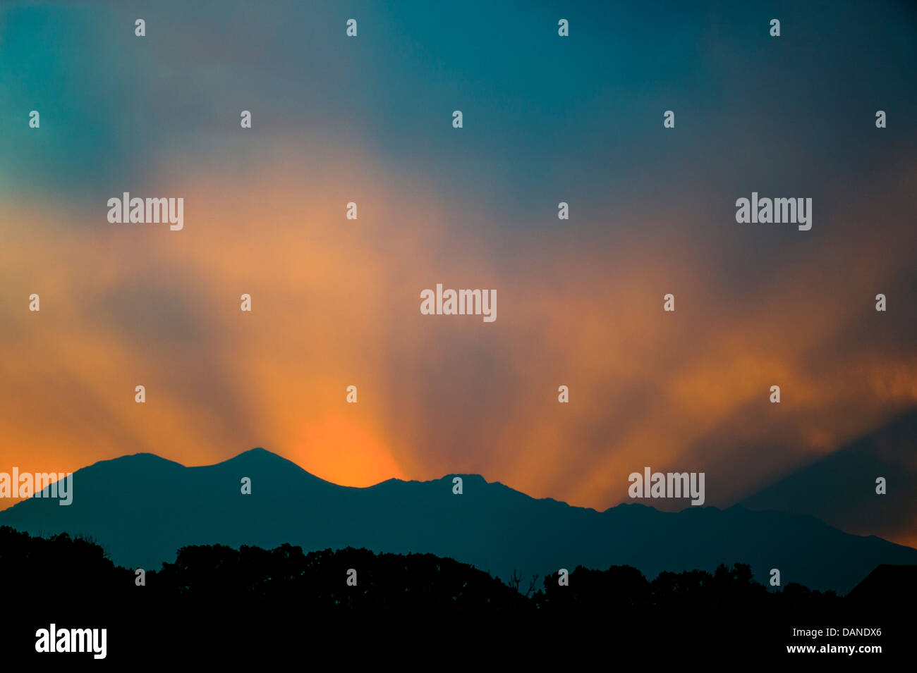 Beams of sunset light over the Rocky Mountains, Central Colorado, USA - Stock Image